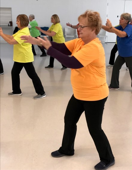Woman participating in a Tai Chi class