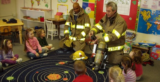 firefighters teaching kids in a classroom about fire safety