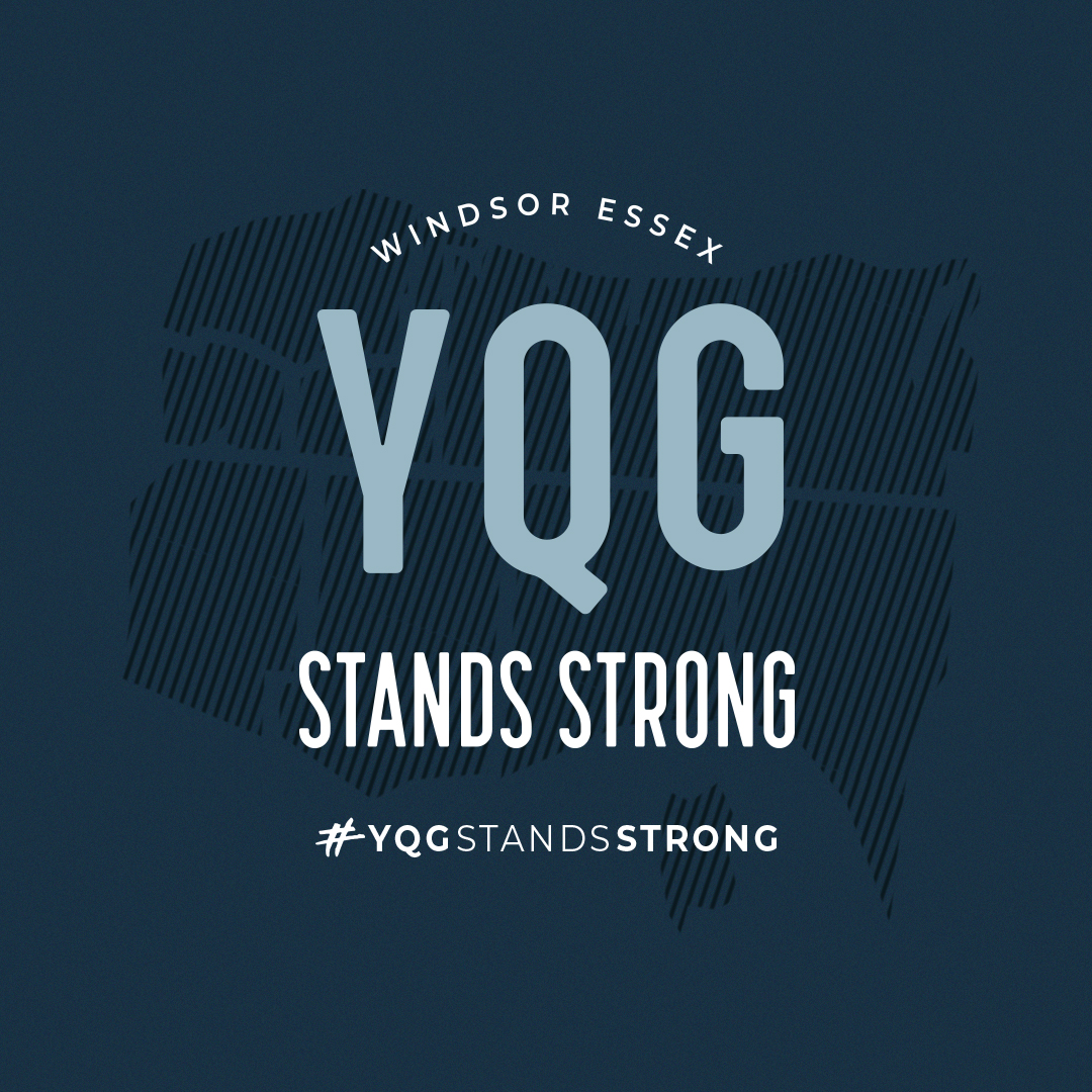 YQG Stands Strong on a dark blue background