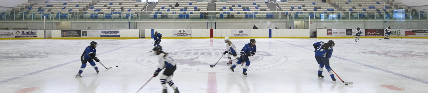Kids playing hockey in the local arena